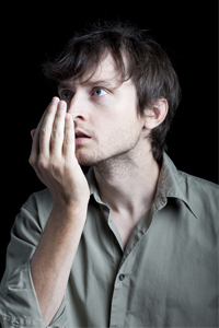 Man Checking his Breath